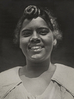 0252399 © Granger - Historical Picture ArchiveCOSTA RICA.   A portrait of a smiling Costa Rican woman, her hair knotted at front. Publishers Photo Service Inc.