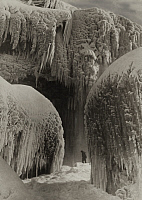 0252540 © Granger - Historical Picture ArchiveNIAGARA FALLS, NEW YORK, UNITED STATES.   A person walks through the crystallized Niagara mists. International Film Service.