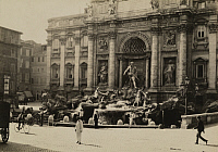 0252767 © Granger - Historical Picture ArchiveROME, ITALY.   People walk by Fontana di Trevi, the most magnificent of fountains. Emil P. Albrecht.