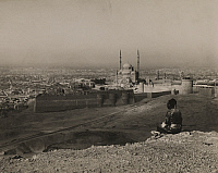 0253150 © Granger - Historical Picture ArchiveMOKATTAM HILLS, CAIRO, EGYPT.   A man sits on the Mokattam Hills overlooking Cairo. Donald Mcleish.