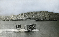 0253263 © Granger - Historical Picture ArchiveLISBON, PORTUGAL.   A seaplane, NC-4, lands in the Tagus River; Libson is in distance. U.S. Gov'T Navy.