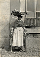 0253298 © Granger - Historical Picture ArchiveLISBON, PORTUGAL.   A vendor balances fish in a basket on her head as she walks the town. A. W. Cutler.