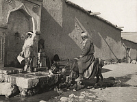 0253311 © Granger - Historical Picture ArchiveKONIA, TURKEY.   A vendor stops at a fountain for his donkey to drink and rest. Charles E. Beury.