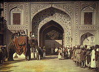 0253548 © Granger - Historical Picture ArchiveJAIPUR, INDIA.   An elephant and soldiers stand in the entrance of Maharaja Palace. Gervais Courtellemont.