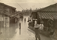 0253588 © Granger - Historical Picture ArchiveTAIWAN, JAPAN.   Locals wade through a street flooded after a typhoon. Taiwan Gov'T Information Office.