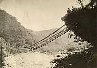 0253618 © Granger - Historical Picture ArchiveTAIWAN, JAPAN.   A rattan suspension footbridge swings above rushing waters. Taiwan Gov'T Information Office.