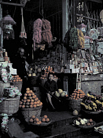 0254104 © Granger - Historical Picture ArchiveRANGOON, MYANMAR.   A Chinese vegetable and fruit stall in a market in Rangoon. Gervais Courtellemont.