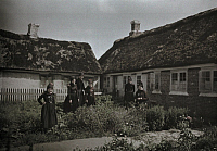 0254164 © Granger - Historical Picture ArchiveFANO, DENMARK.   Women in black stand in a garden behind two houses. Gustav Heurlin.