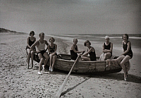 0254165 © Granger - Historical Picture ArchiveSKAGEN, DENMARK.   Young people sit in a boat on the beach. Gustav Heurlin.
