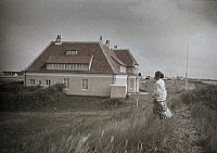 0254166 © Granger - Historical Picture ArchiveSKAGEN, DENMARK.   A woman looks toward a house while standing alongside a road. Gustav Heurlin.