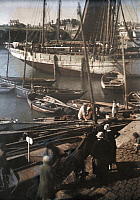 0254392 © Granger - Historical Picture ArchiveTREBOUL, BRITTANY REGION, FRANCE.   Fishermen load goods into their boats. Gervais Courtellemont.