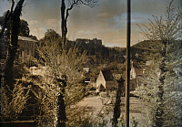 0254442 © Granger - Historical Picture ArchiveFALAISE, CALVADOS, NORMANDY, FRANCE.   A view of Falaise through spring foliage. Gervais Courtellemont.