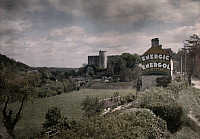 0254443 © Granger - Historical Picture ArchiveFALAISE, CALVADOS, NORMANDY, FRANCE.   A castle seen behind a large advertising sign in the foreground. Gervais Courtellemont.