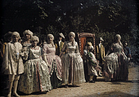 0254537 © Granger - Historical Picture ArchiveFONTAINEBLEAU, SEINE ET MARNE, FRANCE.   Court ladies stand in the forest at an eighteenth-century celebration. Gervais Courtellemont.