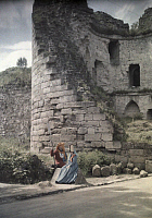 0254546 © Granger - Historical Picture ArchiveCOUCY-LE-CHATEAU, AISNE, SOISSONNOIS, FRANCE.   A lady and soldier stand in costume at the foot of tower ruins. Gervais Courtellemont.