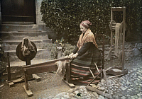0254596 © Granger - Historical Picture ArchiveLUZ VALLEY, FRANCE.   An elderly woman works flax with an old spinning instrument. Gervais Courtellemont.