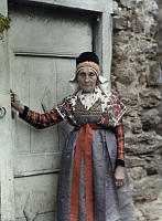 0254656 © Granger - Historical Picture ArchiveBETHMALE VALLEY, MIDI-PYRENEES, FRANCE.   An elderly woman, wearing traditional clothing, stands in a doorway. Gervais Courtellemont.