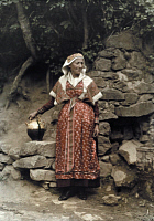 0254657 © Granger - Historical Picture ArchiveBETHMALE VALLEY, MIDI-PYRENEES, FRANCE.   An elderly woman, in her traditional Sunday dress, holds a jug. Gervais Courtellemont.