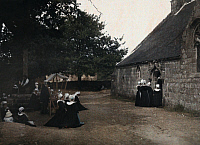 0254793 © Granger - Historical Picture ArchivePONT L'ABBE, BRITTANY, FRANCE.   A crowd, mostly of women, outside of the chapel on absolution day. Gervais Courtellemont.