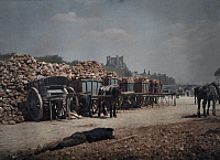 0254836 © Granger - Historical Picture ArchivePARIS, ILE-DE-FRANCE, FRANCE.   Carts piled with rubble and person lying down on the ground. Gervais Courtellemont.