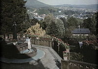 0254970 © Granger - Historical Picture ArchiveBADEN-BADEN, BADEN, GERMANY.   A woman and her baby play next to a fountain overlooking Lichtental. Wilhelm Tobien.