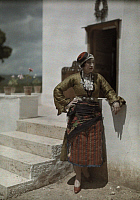0255082 © Granger - Historical Picture ArchiveNEAR KEPHISSIA, GREECE.   Woman at the Delphic Festival poses in costume typical of Khalkidiki. Maynard Owen Williams.