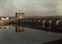0255640 © Granger - Historical Picture ArchiveCORDOVA, SPAIN.   A Moorish bridge on the Guadalquivir River with sixteen arches. Gervais Courtellemont.