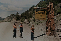 0255912 © Granger - Historical Picture ArchiveRIO GRANDE NATIONAL FOREST, COLORADO, USA.   Two women pose for a photo by the entrance to a National Forest. Luis Marden.