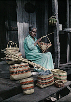 0256012 © Granger - Historical Picture ArchiveNEAR LACOMBE, LOUISIANA, USA.   A Choctaw Indian woman makes baskets from palmetto leaves. Edwin L. Wisherd.