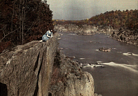 0256193 © Granger - Historical Picture ArchiveGREAT FALLS, VIRGINIA, USA.   A woman enjoys the view of the Potomac River from a cliff above. Clifton R. Adams.