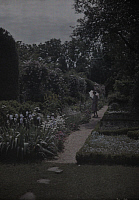 0256197 © Granger - Historical Picture ArchiveNEAR FREDERICKSBURG, VIRGINIA, USA.   A woman walks through an old estate near Fredericksburg. Clifton R. Adams.