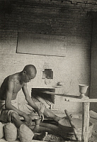 0256350 © Granger - Historical Picture ArchiveCHING-TEH-CHEN, CHINA.   A Chinese potter works at his wheel. Frank B. Lenz.