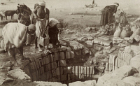 0256369 © Granger - Historical Picture ArchivePALESTINE: BEERSHEBA.   Men gather water from an old well in Beersheba. Archibald Forder.