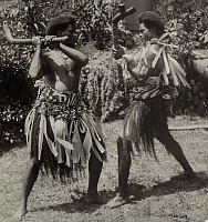 0256546 © Granger - Historical Picture ArchiveFIJI ISLANDS.   Two Fijian men demonstrate a traditional meke club dance in costume. Robert A. Bachmann.