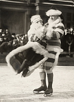 0256566 © Granger - Historical Picture ArchiveST. PAUL, MINNESOTA, USA.   A couple figure skate together in costume. No Credit Given.