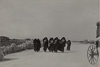 0256667 © Granger - Historical Picture ArchiveMALTA.   A group of women in traditional Maltese clothing walk up a dusty road. S.L. Cassar.