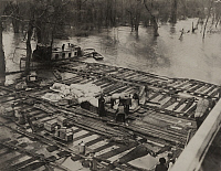 0257813 © Granger - Historical Picture ArchiveNEBLETT, MISSISSIPPI, USA.   Refugees of a flood await rescue on a log raft in middle of river. H. C. Frankenfield.