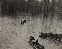0257815 © Granger - Historical Picture ArchiveMODOC, ARKANSAS, USA.   Families escape a flood of the Mississippi on rowboats and canoes. H. C. Frankenfield.