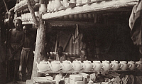 0257826 © Granger - Historical Picture ArchiveCHING-TEH-CHEN, CHINA.   A vendor lines up his merchandise of teapots side by side. Frank B. Lenz.