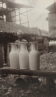 0257827 © Granger - Historical Picture ArchiveCHING-TEH-CHEN, CHINA.   A potter stands behind unfinished porcelain vases. Frank B. Lenz.