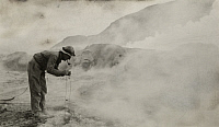 0258137 © Granger - Historical Picture ArchiveVALLEY OF TEN THOUSAND SMOKES, ALASKA.   A scientist examines a hot fumarole found in the national park. Paul R. Hagelbarger.