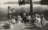 0258164 © Granger - Historical Picture ArchiveSWEDEN.   A young boy delivers a speech to attentive friends. Gustav Heurlin.