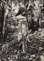 0258339 © Granger - Historical Picture ArchiveMARQUESAS ISLANDS, FRENCH POLYNESIA.   A young Polynesian girl holds a palm leaf in the jungle. John W. Church.