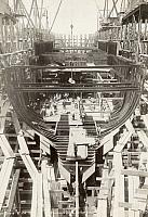 0258425 © Granger - Historical Picture ArchiveSHIP CONSTRUCTION.   The framework of a steel ship comes together in a shipyard dry dock. No Credit Given.