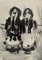 0258586 © Granger - Historical Picture ArchiveALASKA, USA.   Two Alaskans in traditional fur coats stand in the snow. Lomen Brothers.