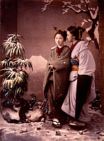 0073568 © Granger - Historical Picture ArchiveJAPAN: WOMEN IN SNOW.   Two women in snow with Mt. Fuji in background (studio scene). Hand-tinted albumen photograph by Baron von Stillfried, c1870.