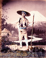 0073578 © Granger - Historical Picture ArchiveJAPAN: PILGRIM & MT. FUJI.   Pilgrim and Mt. Fuji (Studio scene). Hand-tinted albumen photograph by Baron von Stillfried, c1870.
