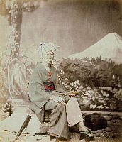 0075948 © Granger - Historical Picture ArchiveJAPAN: PILGRIM AT MT. FUJI.   A Japanese pilgrim at the foot of Mt. Fuji. Hand-tinted albumen photograph by Beato, 1863-1866.