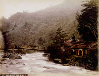0075950 © Granger - Historical Picture ArchiveJAPAN: WATERMILL, 1880s.   A bridge and watermill at Nikko, Japan. Hand-tinted albumen photograph by Farsari & Co., 1880s.