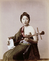 0075954 © Granger - Historical Picture ArchiveJAPAN: MUSICIAN, c1885.   Japanese woman playing the shamisen. Hand-tinted albumen photograph by Farsari & Co., 1885-1900.